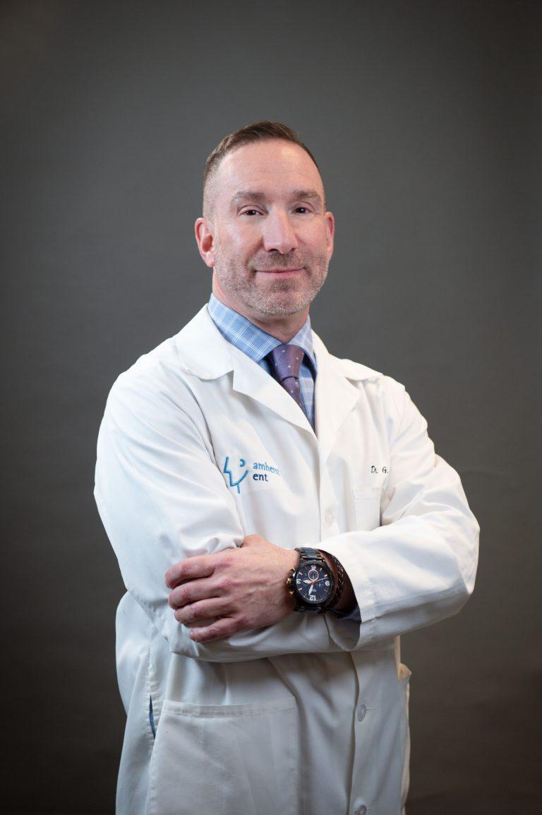 Dr Gregg Zimmer In a Lab Coat