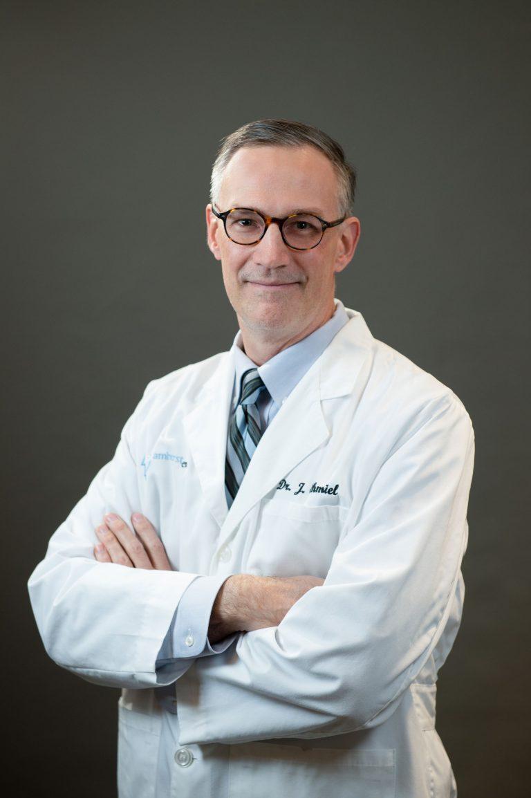 Dr James Chmiel in a lab coat